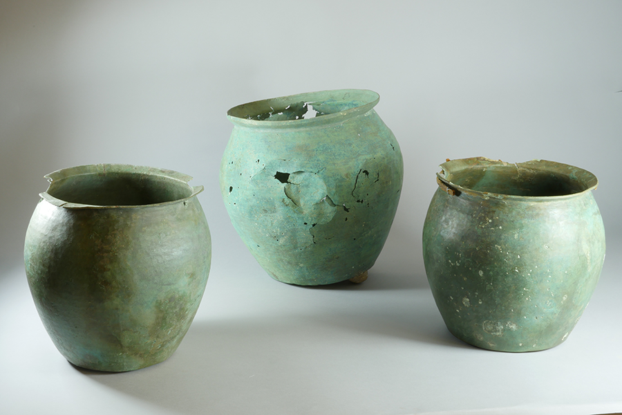 e. Bronze Roman buckets found in the Roman levels of Well # 1