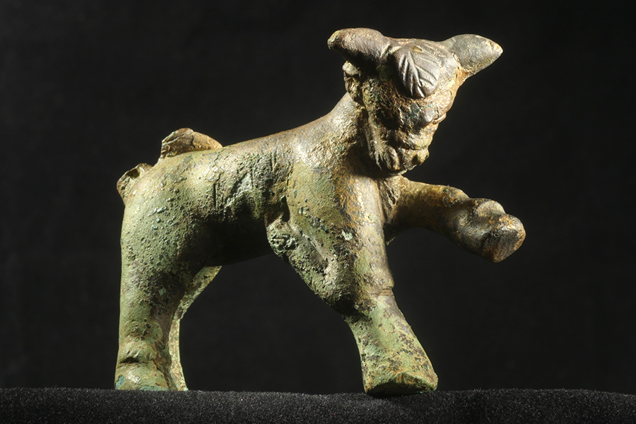 f. Miniature bronze Roman bull found in Well # 1