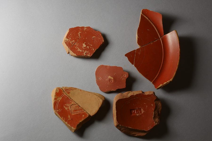 g. Roman red-gloss pottery from Arezzo, often with artisans' stamps and decorations, 1st century BCE-1st century CE
