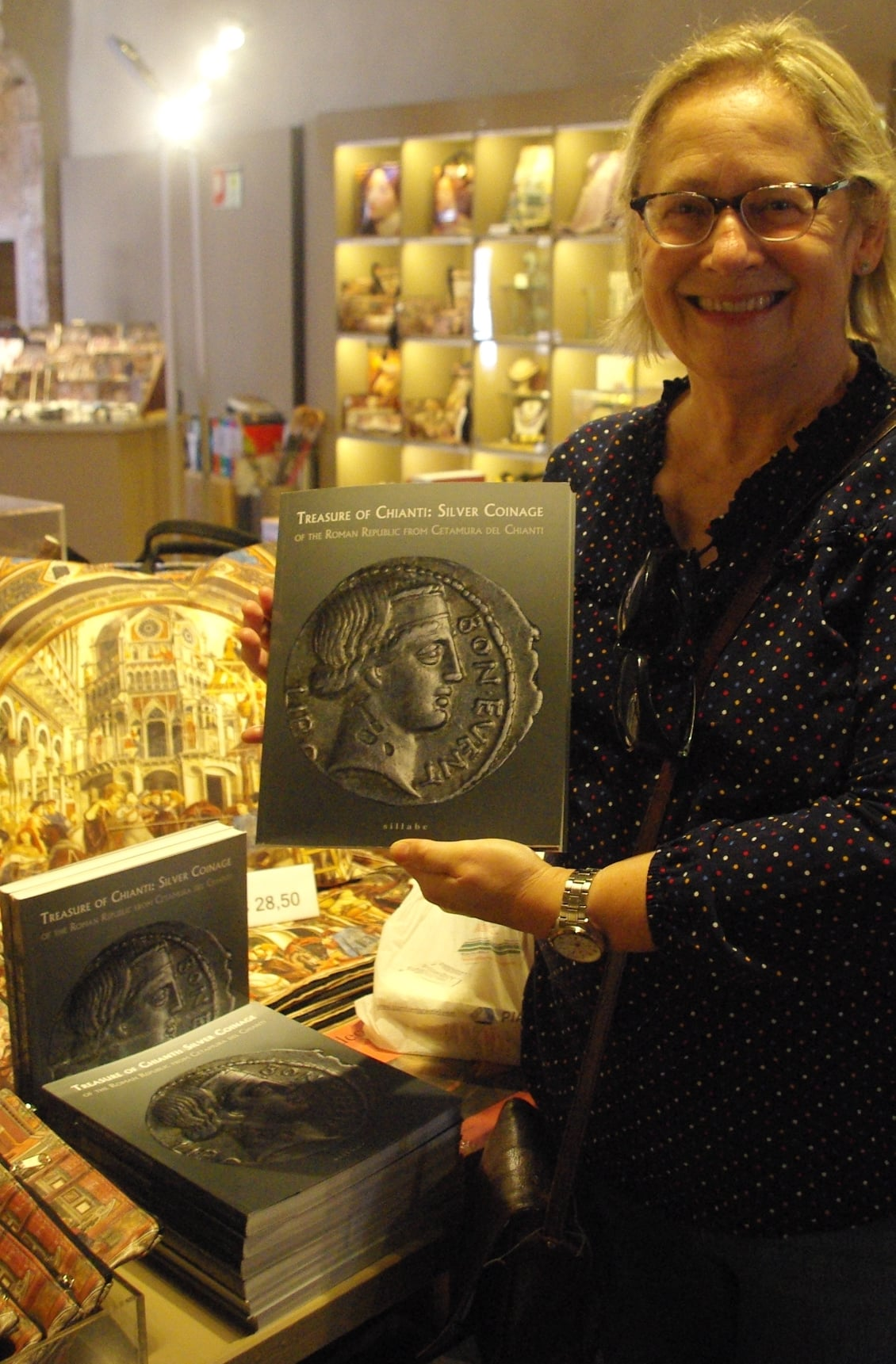 Holland Goldthwaite holds book from exhibition